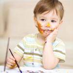 Kindergarten boy painting